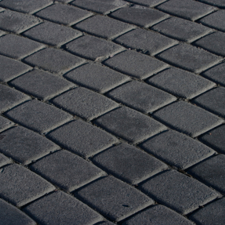 block paving contractors laying driveway in black paving